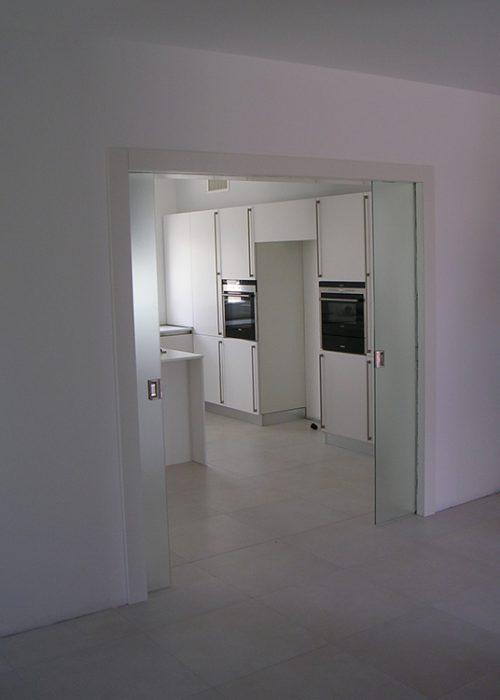 Porta doppia scorrevole tuttovetro padova realizzazione for Doppia porta scorrevole