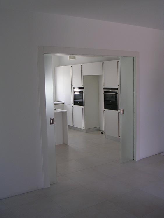Porta doppia scorrevole tuttovetro padova realizzazione - Porta scorrevole doppia ...