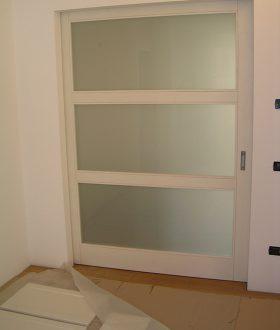 Porta scorrevole esterno muro in vetro-legno