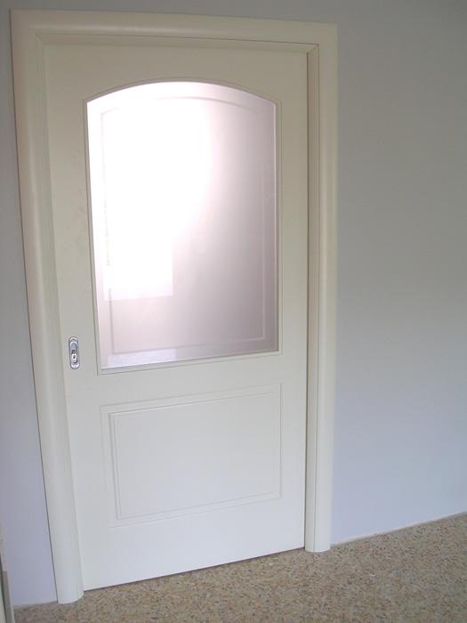 Porta scorrevole vetro e legno modello pantografato for Porta a libro bianca con vetro
